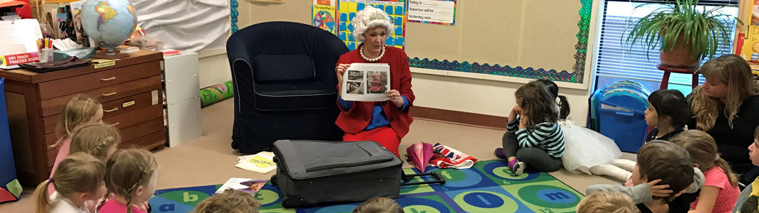 Visitor dressed as a book character reading to prechoolers