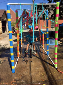 One Preschool child playing on an outdoor play structure